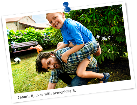 Jason, who lives with hemophilia B, plays with his dad in a garden